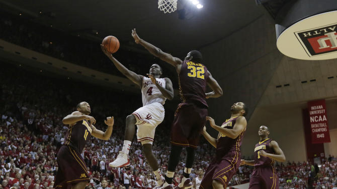 Indiana's Victor Oladipo (4) puts up a shot against Minnesota's Trevor Mbakwe (32) during the second half of an NCAA college basketball game Saturday, Jan. 12, 2013, in Bloomington, Ind. Indiana defeated Minnesota 88-81. (AP Photo/Darron Cummings)