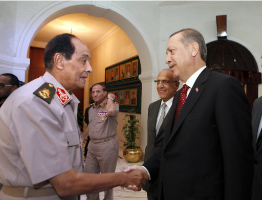 Field Marshal Mohamed Hussein Tantawi, head of Egypt's ruling military council, left, greets Turkish Prime Minister Recep Tayyip Erdogan, upon his arrival at the defence ministry in Cairo, Egypt, Tuesday, Sept. 13, 2011. At second left, chief of staff of the Egyptian armed forces Sami Anan. Erdogan, intent on broadening Turkey's influence in the Middle East and the Arab world, started a visit to Egypt and will also visit Tunisia and Libya, two other countries where popular uprisings have ousted autocratic leaders. (AP Photo/Amr Nabil, Pool)