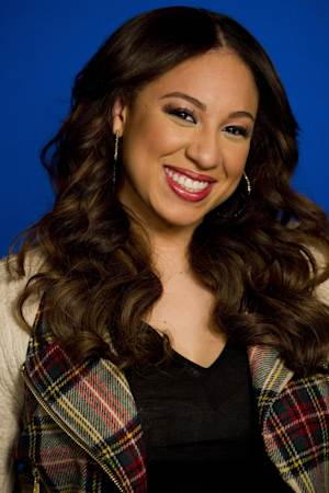 "Melanie Amaro, winner of the singing competition series ""The X Factor,"" poses for a portrait in New York, Wednesday, Jan. 4, 2012. (AP Photo/Charles Sykes)"