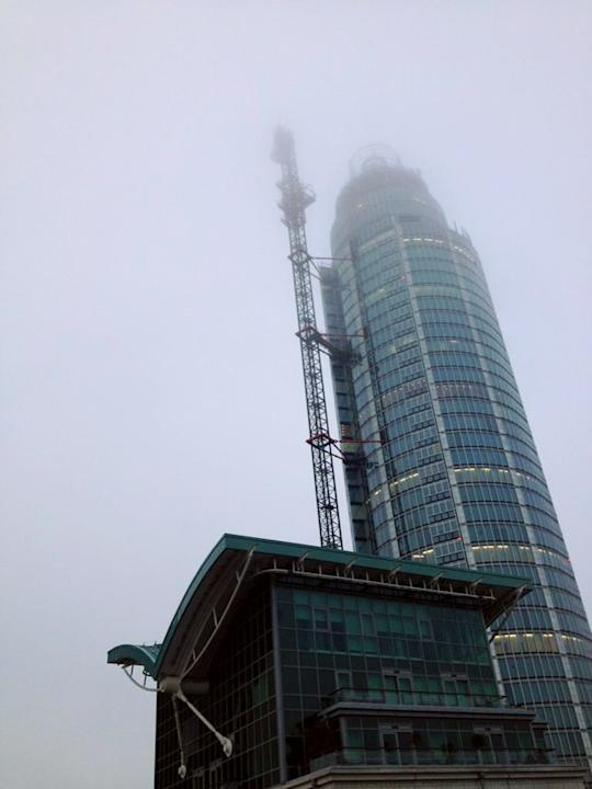 LONDON, UNITED KINGDOM - JANUARY 16: (BEST QUALITY AVAILABLE)  Mist shrowds St Georges Wharf Tower after  a nearby helicopter crash on January 16, 2012 in London, England.  The helicopter appeared to