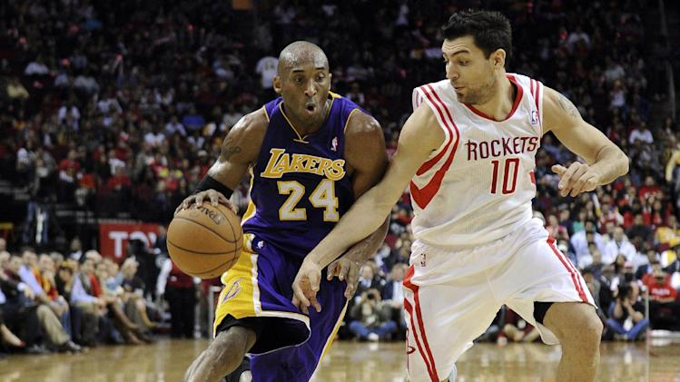Los Angeles Lakers' Kobe Bryant (24) drives the ball past Houston Rockets' Carlos Delfino (10) in the first half of an NBA basketball game Tuesday, Jan. 8, 2013, in Houston. (AP Photo/Pat Sullivan)