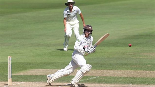 Surrey boosted by twin centurions