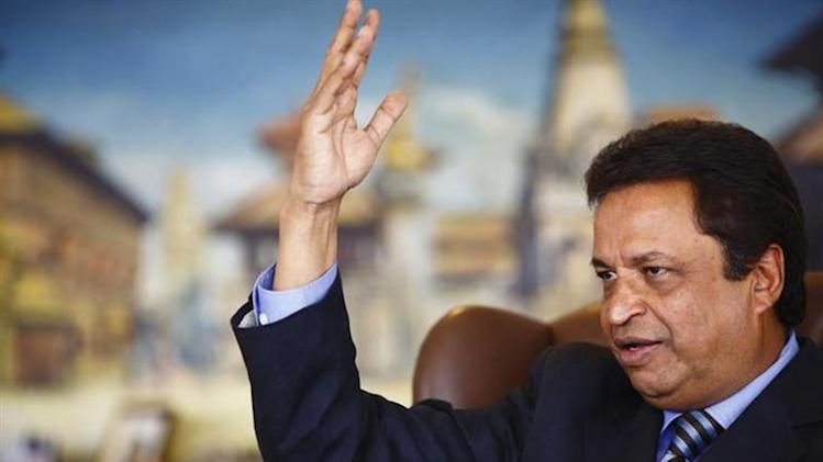 Nepal's only billionaire Binod Chaudhary, whom Forbes valued at a billion dollars in March, gestures as he speaks with Reuters during an interview at his office at Chaudhary Group in Kathmandu October 4, 2013. REUTERS/Navesh Chitrakar