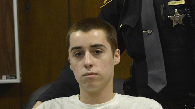 T.J. Lane sits in court during sentencing Tuesday, March 19, 2013, in Chardon, Ohio.  Lane, was given three lifetime prison sentences without the possibility of parole Tuesday for opening fire last year in a high school cafeteria in a rampage that left three students dead and three others wounded.  Lane, 18, had pleaded guilty last month to shooting at students in February 2012 at Chardon High School, east of Cleveland. Investigators have said he admitted to the shooting but said he didn't know why he did it. Before the case went to adult court last year, a juvenile court judge ruled that Lane was mentally competent to stand trial despite evidence he suffers from hallucinations, psychosis and fantasies. (AP Photo/The News-Herald, Duncan Scott, Pool)