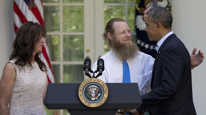 FILE - In this Saturday, May 31, 2014 file photo, President Barack Obama shakes hands with Bob Bergdahl as Jani Bergdahl stands at left, during a news conference in the Rose Garden of the White House in Washington about the release of their son, U.S. Army Sgt. Bowe Bergdahl. The soldier went missing from his outpost in Afghanistan in June 2009 and was released from Taliban captivity on May 31, 2014 in exchange for five enemy combatants held in the U.S. prison in Guantanamo Bay, Cuba. (AP Photo/Carolyn Kaster)