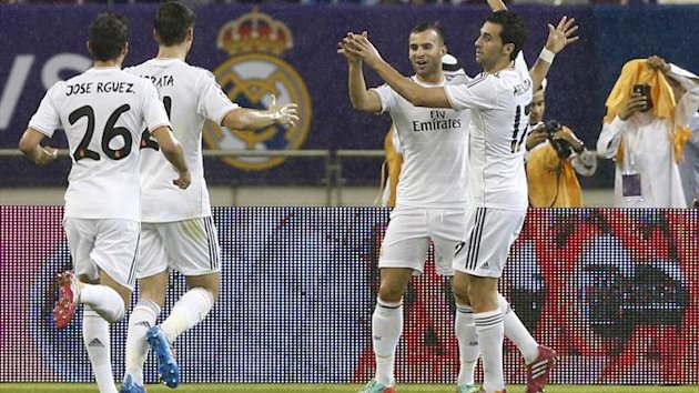 Real Madrid's Jese (2nd R) celebrates with teammates after scoring against Paris St Germain during their friendly soccer match at Khalifa stadium in Doha (Reuters)