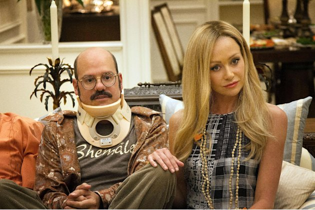 "This undated publicity photo released by Netflix shows David Cross, left, and Portia de Rossi in a scene from ""Arrested Development,"" premiering May 26, 2013 on Netflix. The sitcom, also starring Jaso"