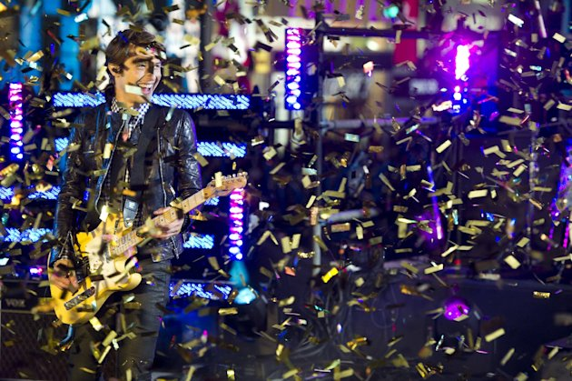 Ryan Follese from the band Hot Chelle Rae performs in Times Square during the New Year's Eve celebration, Saturday, Dec. 31, 2011, in New York. (AP Photo/Charles Sykes)