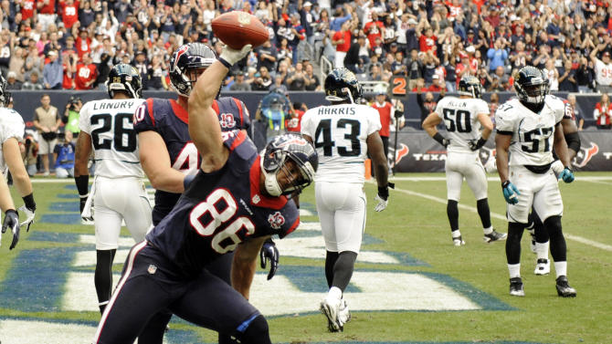 Houston Texans fullback James Casey (86) spikes the ball after scoring a touchdown against the Jacksonville Jaguars during the second quarter of an NFL football game, Sunday, Nov. 18, 2012, in Houston. (AP Photo/Dave Einsel)