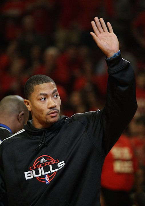 Derrick Rose #1 Of The Chicago Bulls, Injured In Game One Against The Philadelphia 76ers, Waves Getty Images