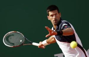 Novak Djokovic of Serbia returns the ball to Pablo Carreno-Busta of Spain during the Monte Carlo Masters in Monaco