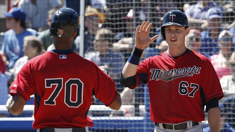 Minnesota Twins Max Kepler (67) greets the Twins Byron Buxton (70) at the plate after scoring on Buxton's third-inning, two-run home run in a spring training baseball game against the Toronto Blue Jays in Dunedin, Fla., Saturday, March 8, 2014. (AP Photo/Kathy Willens)