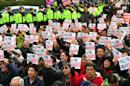 South Korean protesters shout slogans during a protest outside the headquarters of the ruling Saenuri Party in Seoul on December 3, 2016