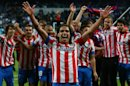 Atletico de Madrid&#039;s Radamel Falcao from Colombia, center, and teammates celebrate defeating Real Madrid in the Copa del Rey final soccer match at the Santiago Bernabeu stadium in Madrid, Spain, Friday, May 17, 2013. (AP Photo/Andres Kudacki)