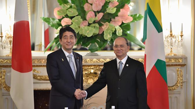 Sein shakes hands with Abe prior to their talks at the Akasaka State Guest House in Tokyo