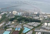 An aerial view shows Tokyo Electric Power Co. (TEPCO)'s tsunami-crippled Fukushima Daiichi nuclear power plant and its contaminated water storage tanks (bottom) in Fukushima, in this file photo taken by Kyodo August 20, 2013. REUTERS/Kyodo/Files