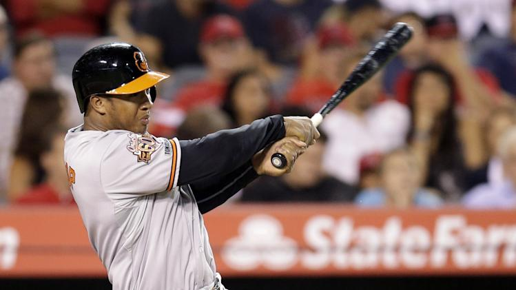 Baltimore Orioles' Jonathan Schoop hits a two-run home run during the sixth inning of a baseball game against the Los Angeles Angels on Tuesday, July 22, 2014, in Anaheim, Calif. (AP Photo)