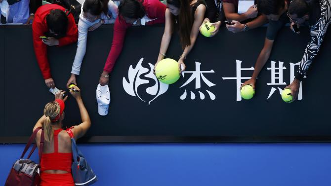 Sharapova of Russia signs autographs after defeating compatriot Makarova in their women's singles semi-final match at the Australian Open 2015 tennis tournament in Melbourne