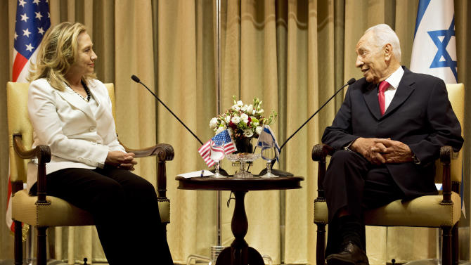Israel's President Shimon Peres, right, and U.S. Secretary of State Hillary Rodham Clinton, left, meet at the President's residence in Jerusalem, Monday, July 16, 2012. Clinton made perhaps her final visit to Israel as secretary of state on Monday, bringing a message of solidarity to the Jewish state after three-and-a-half years of only stunted progress toward a Palestinian peace deal. (AP Photo/ Brendan Smialowski, Pool)