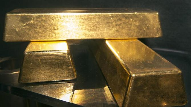 Illustration. Thirty bars of 24-carat gold lie buried under the sand of Folkestone's Outer Harbour beach in Kent, ready to be dug up by treasure-seekers