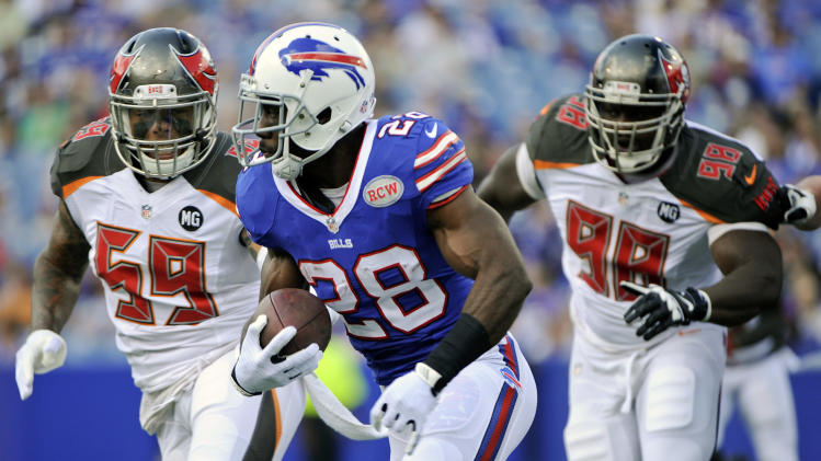 Tampa Bay Buccaneers middle linebacker Mason Foster (59) and Clinton McDonald (98) chase Buffalo Bills running back C.J. Spiller (28) during the first half of a preseason NFL football game Saturday, Aug. 23, 2014, in Orchard Park, N.Y. (AP Photo/Gary Wiepert)