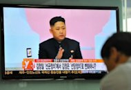"A South Korean man watches a TV newscast reporting about the ""marshal"" title of North Korea's leader Kim Jong-Un at a railway station in Seoul"