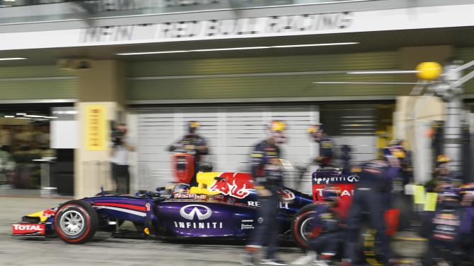 Red Bull Formula One driver Vettel leaves the pit during the Abu Dhabi F1 Grand Prix