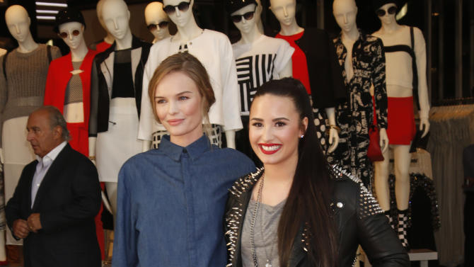Kate Bosworth and Demi Lovato attend Sir Philip Green's British Street Party to celebrate the Opening of TOPSHOP and TOPMAN at The Grove on Thursday, Feb. 14, 2013 in Los Angeles. (Photo by Todd Williamson/Invision/AP)