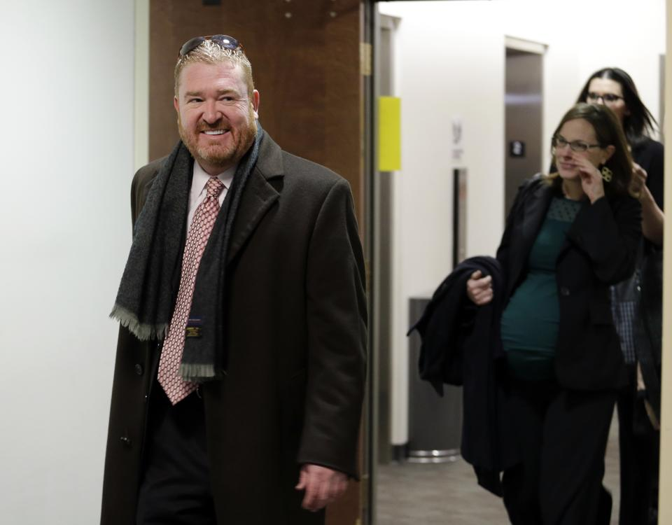 Defense attorney Daniel King leads his team to court for a hearing for Aurora theater shooting suspect James Holmes at the courthouse in Centennial, Colo., on Friday, Jan. 11,  2013. (AP Photo/Ed Andrieski)