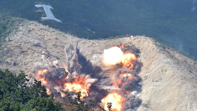 Bombs explode on a mountain range during a joint live firing drill between South Korea and the US at the Seungjin Fire Training Field in Pocheon, 65 kms northeast of Seoul, on August 28, 2015