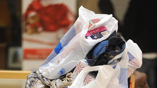 A Black Friday shopper takes a rest with purchases at Northpark Mall in Ridgeland, Miss., on Friday, Nov. 25, 2011. (AP Photo/The Clarion-Ledger, Vickie D. King) NO SALES