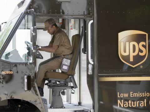 A UPS driver gets into his truck to make downtown deliveries Wednesday, April 23, 2008, in Atlanta. UPS Inc., the world's largest shipping carrier, sa...