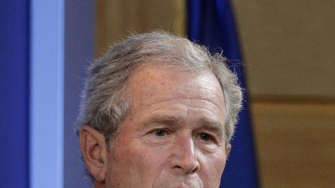 In this April 12, 2011 photo, former president George W. Bush makes opening remarks at the The 4% Project, Driving Economic Growth conference at SMU in Dallas. Former President George W. Bush is skipping the Republican National Convention next month in Tampa, Fla., where presumptive GOP nominee Mitt Romney will officially become the party's standard-bearer.(AP Photo/Tony Gutierrez)