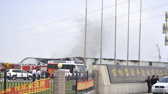 In this photo released by China's Xinhua News Agency, smoke rises from a poultry farm at the Jilin Baoyuanfeng Poultry Company in Mishazi township of Dehui City, northeast China's Jilin Province Monday, June 3, 2013. At least 43 people were killed on Monday morning in the poultry processing plant fire. Reports say 43 people have died in the fire which broke out Monday morning. (AP Photo/Xinhua, Wang Haofei) NO SALES