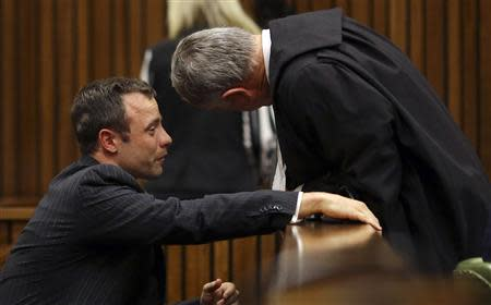 Olympic and Paralympic track star Oscar Pistorius cries during his trial for the murder of his girlfriend Reeva Steenkamp, at the North Gauteng High Court in Pretoria