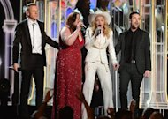 "Macklemore (L), Ryan Lewis (2ndR), Mary Lambert (2ndL), Madonna (C) perform the song ""Same Love"" during the 56th Grammy Awards at the Staples Center in Los Angeles, California, January 26, 2014"