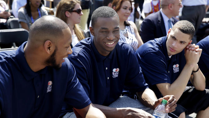 Michigan State's Adreian Payne, left, Kansas' Andrew Wiggins, center, and UCLA's Zack LaVine talk before a kids basketball clinic in New York, Wednesday, June 25, 2014. The 2014 draft prospects are in town for the NBA draft in Brooklyn, New York on June 26, 2014. (AP Photo/Seth Wenig)