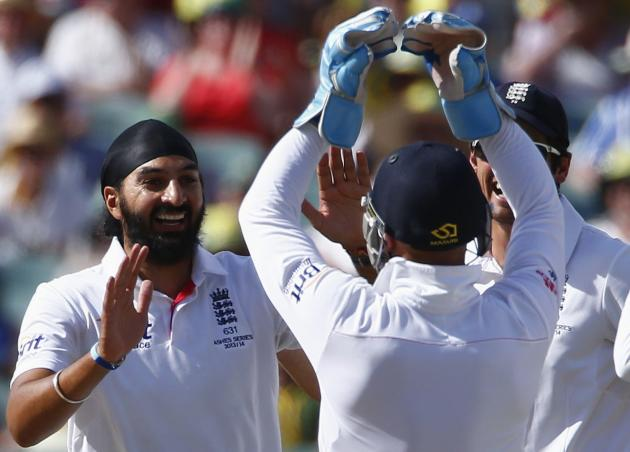 England's Panesar celebrates with teammates after taking the wicket of Australia's captain Clarke during the third day's play in the second Ashes cricket test at the Adelaide Oval