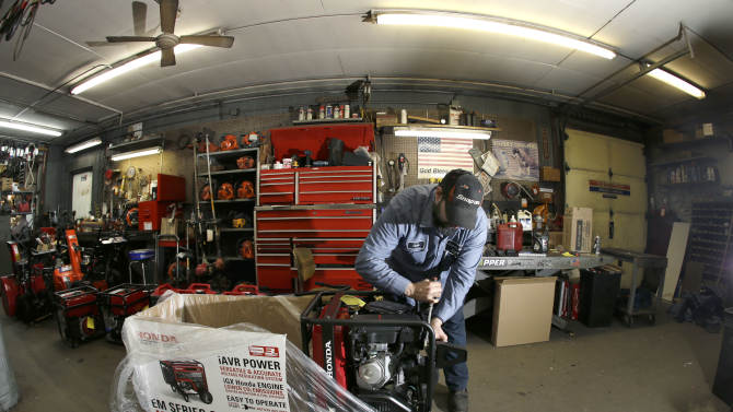 Chris Oppenberg of Andover Small Engine Service assembles a home generator for a customer in Andover, Mass., Thursday, Feb. 7, 2013, in preparation for a major winter storm headed toward the U.S. Northeast. The National Weather Service calls for up to 2 feet of snow expected for a Boston-area region that has seen mostly bare ground this winter. (AP Photo/Elise Amendola)
