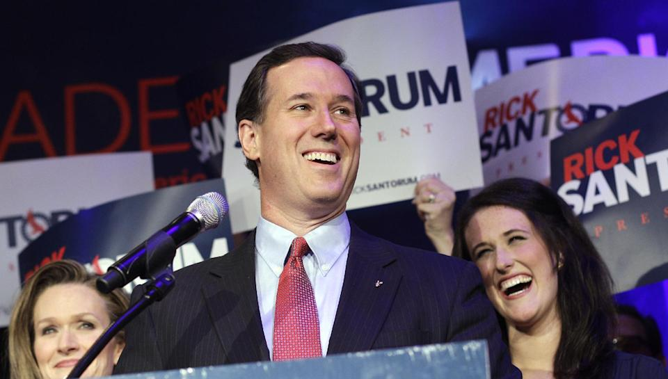 Republican presidential candidate, former Pennsylvania Sen. Rick Santorum arrives for his primary election night party, Tuesday, Feb. 28, 2012, in Grand Rapids, Mich. Santorum's wife, Karen, left, and daughter, Elizabeth, right, look on. (AP Photo/Eric Gay)
