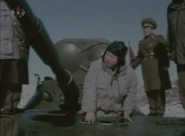"""In this undated image made from KRT video, North Korea's new young leader Kim Jong Un gets out of a military vehicle at an undisclosed place in North Korea, aired Sunday, Jan. 8, 2012. Kim Jong Un, who was named """"supreme leader"""" of North Korea's people, ruling Workers' Party and military following the death last month of his father, Kim Jong Il, was shown observing firing exercises and posing for photographs with soldiers in footage that was shot before his father's death and aired as a documentary Sunday."""