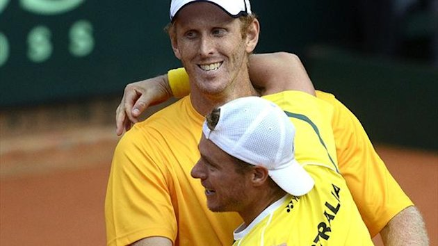 Australia's Lleyton Hewitt celebrates with Chris Guccione (Reuters)