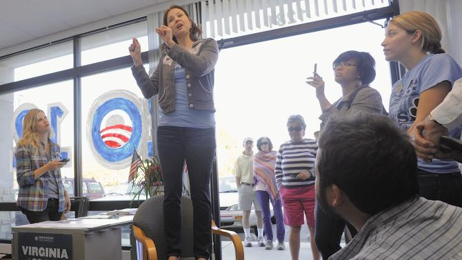 Actress Ashley Judd, center, gives a pep talk to volunteers for the Obama for President campaign at the Fredericksburg, Va. office on Sunday, Oct. 21, 2012. (AP Photo/The Free Lance-Star, Robert A. Martin)