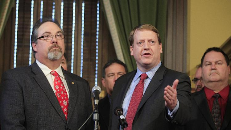 Michigan House Democratic Leader Elect Tim Greimel, right, and current House Democratic Leader Rick Hammel, left, meet with the media, in Lansing, Mich., Monday, Dec. 10, 2012, to denounce the state's right-to-work legislation which was passed last week in Lansing. (AP Photo/Carlos Osorio)