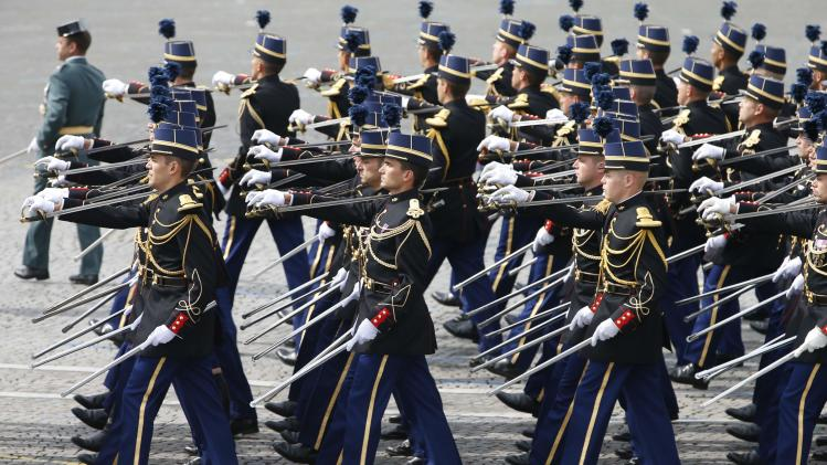Members of the French National gendarmerie officers school march during the traditional Bastille Day parade on the Place de la Concorde in Paris