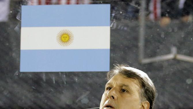 Argentina's head coach Martino sits on the bench before the 2018 World Cup qualifying soccer match against Paraguay at the Defensores del Chaco stadium in Asuncion