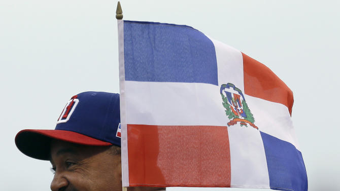 The Dominican Republic's manager Tony Pena smiles as he introduced before a semifinal game of the World Baseball Classic against the Netherlands in San Francisco, Monday, March 18, 2013. (AP Photo/Ben Margot)