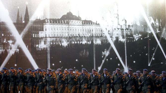 Russian servicemen march in formation before rehearsal for Victory parade on Moscow's Red Square
