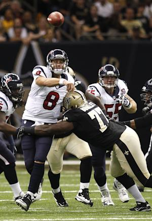 Houston Texans quarterback Matt Schaub (8) passes under pressure from New Orleans Saints defensive tackle Brodrick Bunkley (77) in the first half of an NFL preseason football game in New Orleans, Saturday, Aug. 25, 2012. (AP Photo/Bill Haber)