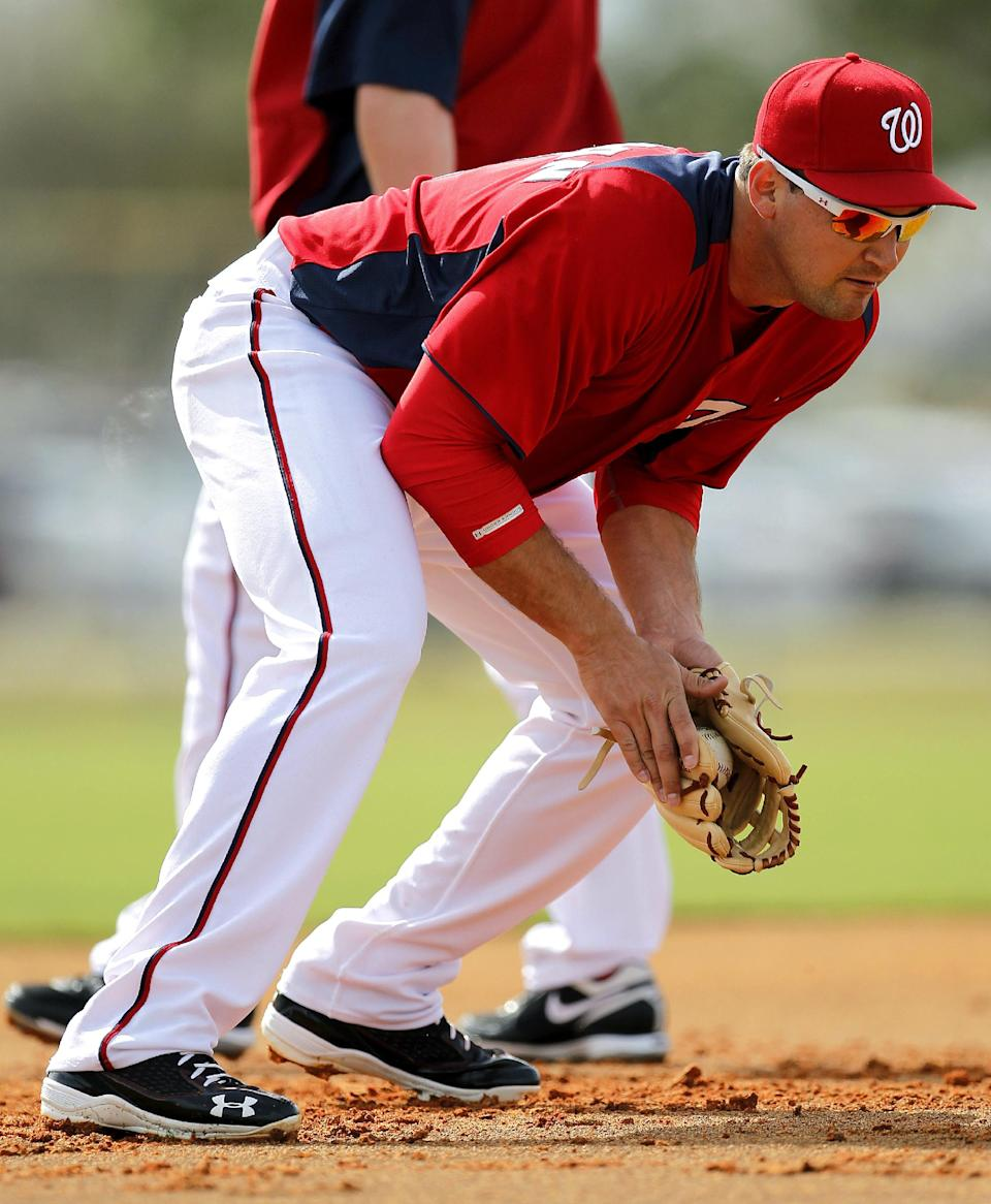 Washington Nationals third baseman Ryan Zimmerman fields a ground ball during the team's first official full squad workout at spring training baseball, Saturday, Feb. 25, 2012, in Viera, Fla. (AP Photo/Julio Cortez)